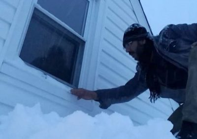 House Inspection In Snow By a House Inspector
